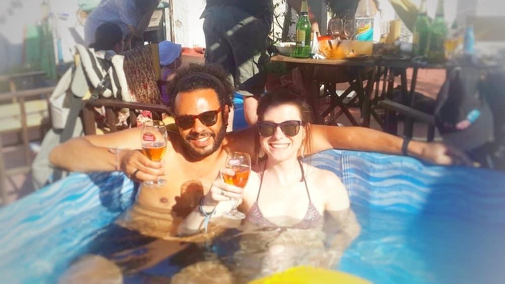 James and Sarah chilling in the pool with some beers