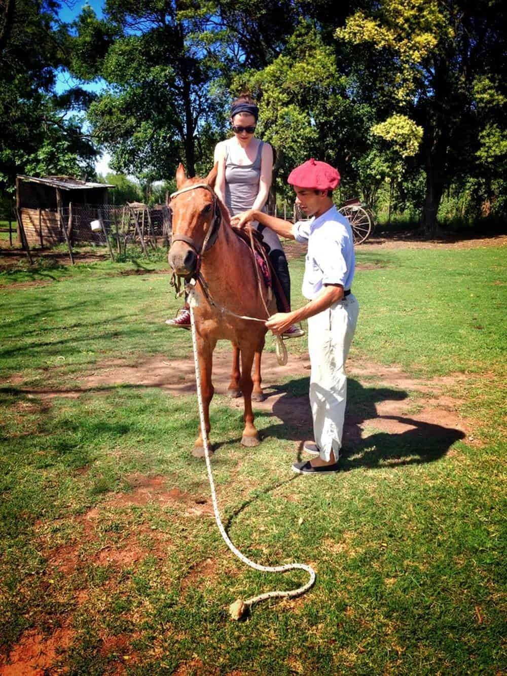 Sarah riding a horse