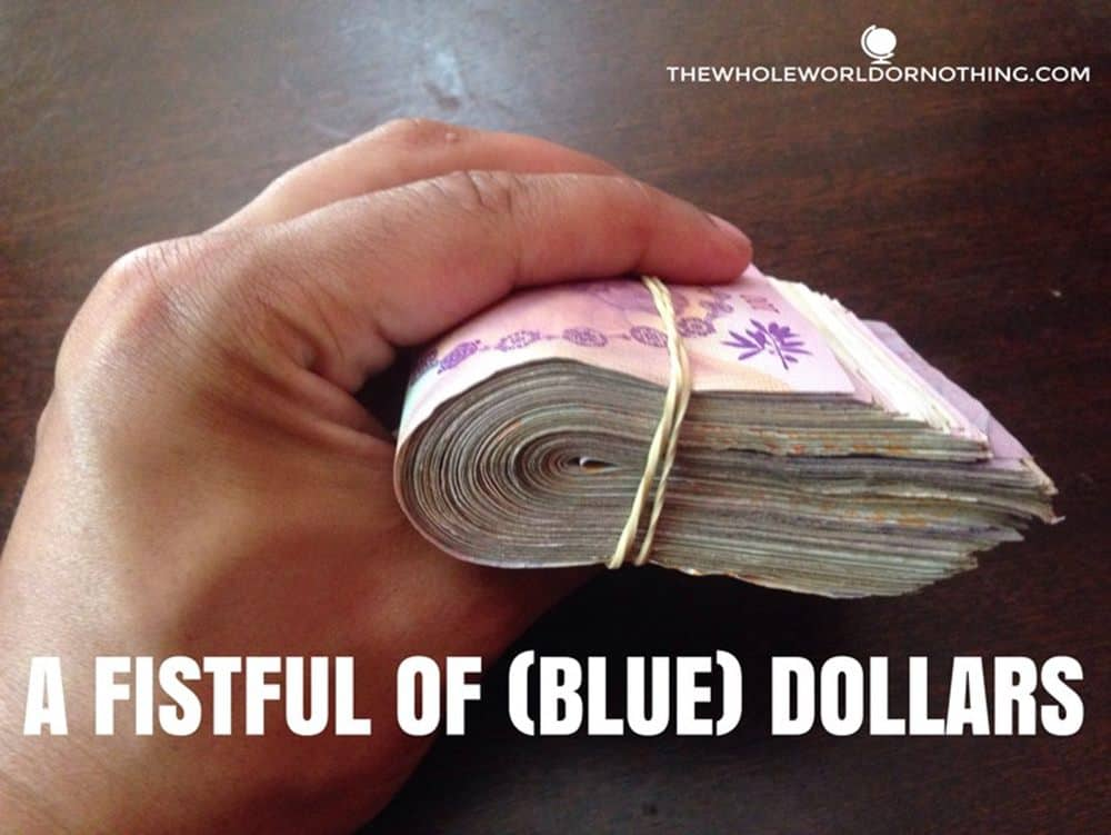 14,400 Argentine Pesos with text overlay A fistful of (blue) dollars