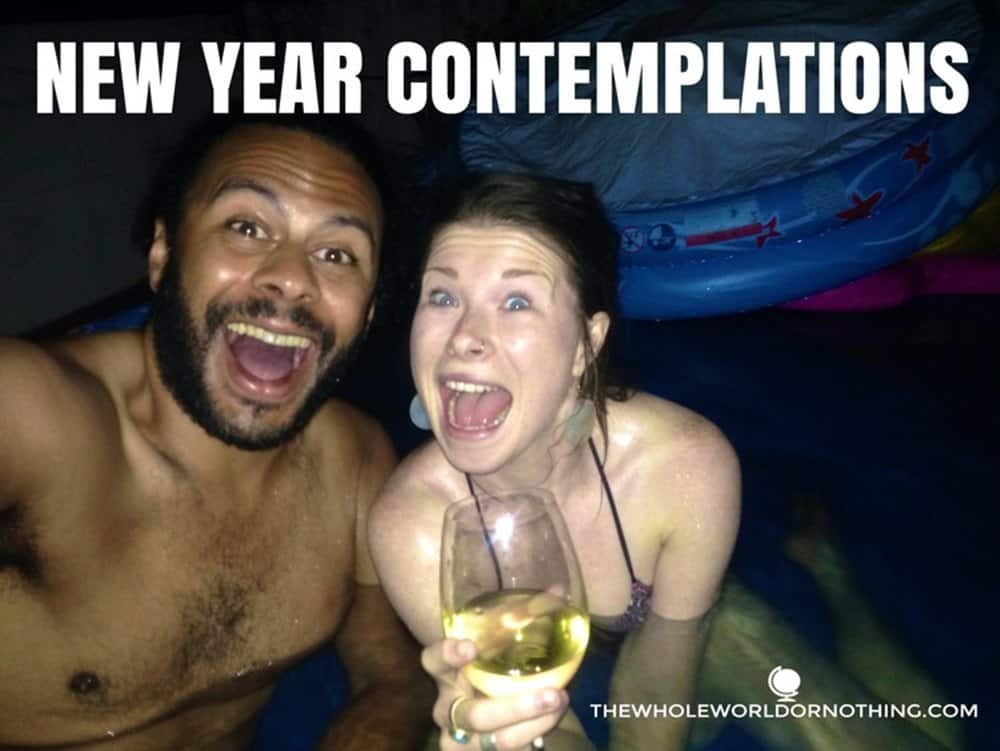 James and Sarah on a pool with wine with text overlay New year contemplations