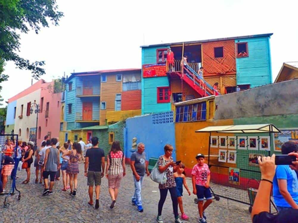 colorful houses with walking people