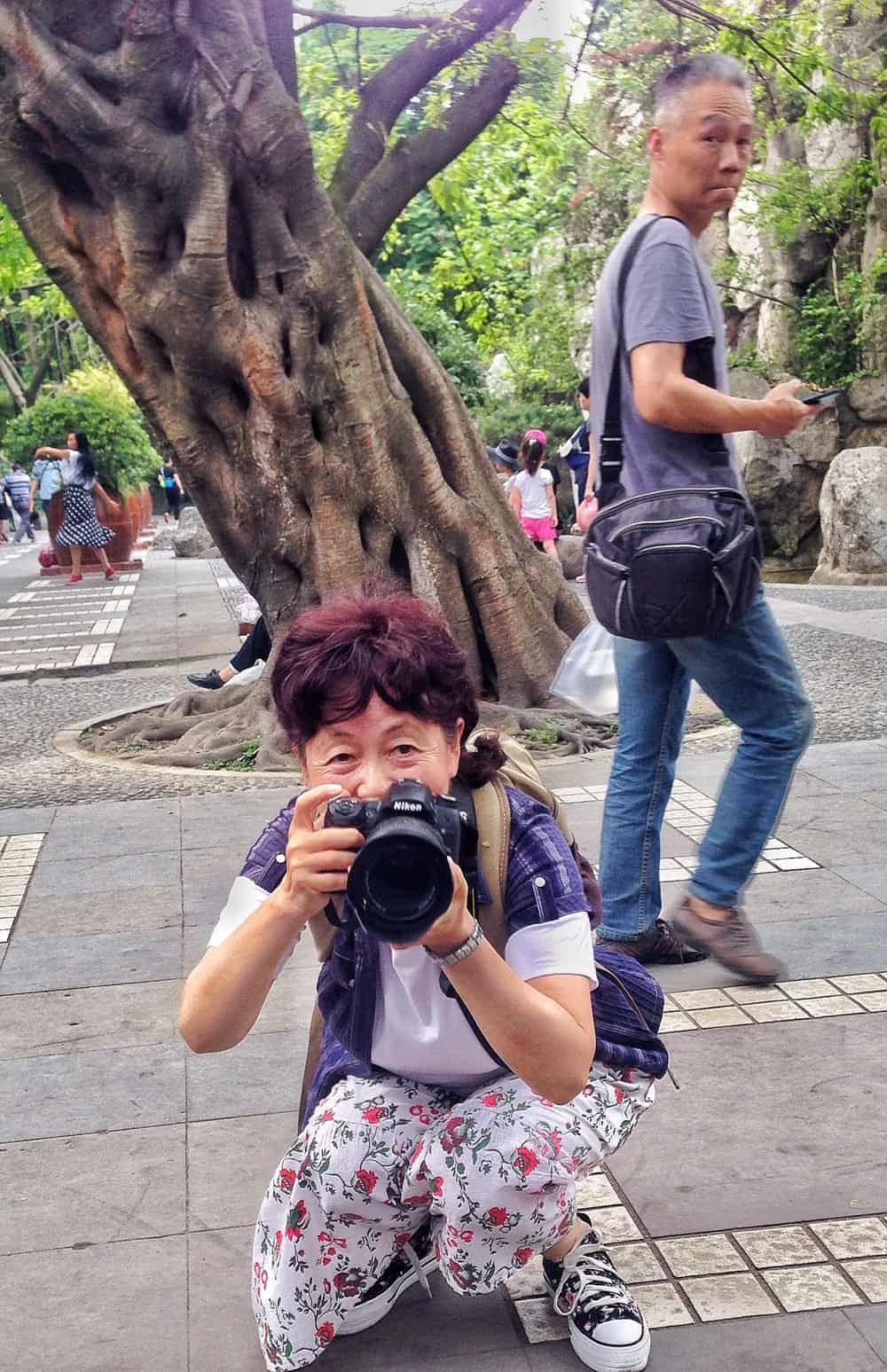 old woman capturing photo