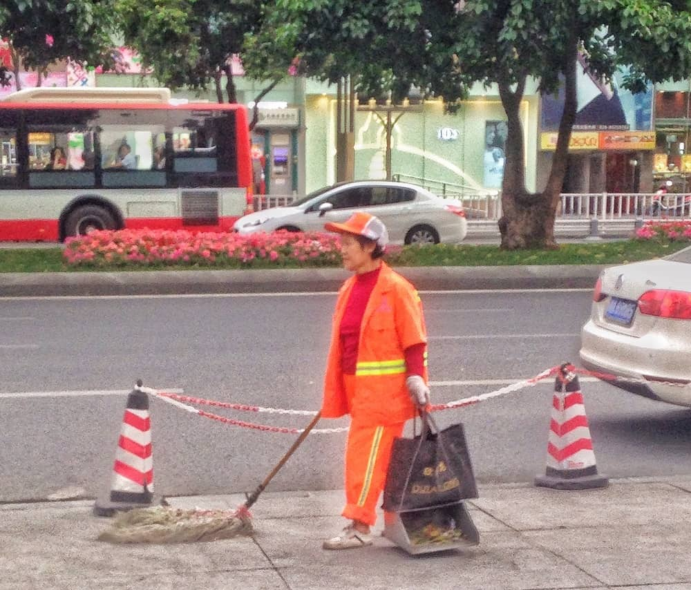 woman cleaning streets