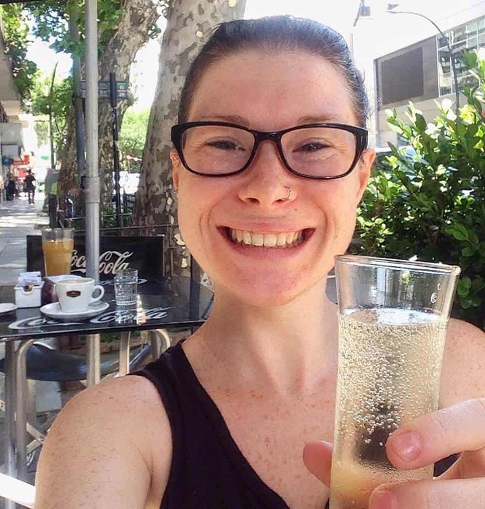 Sarah holding a drink