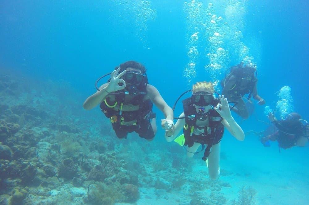 James and Sarah diving 10 meters down