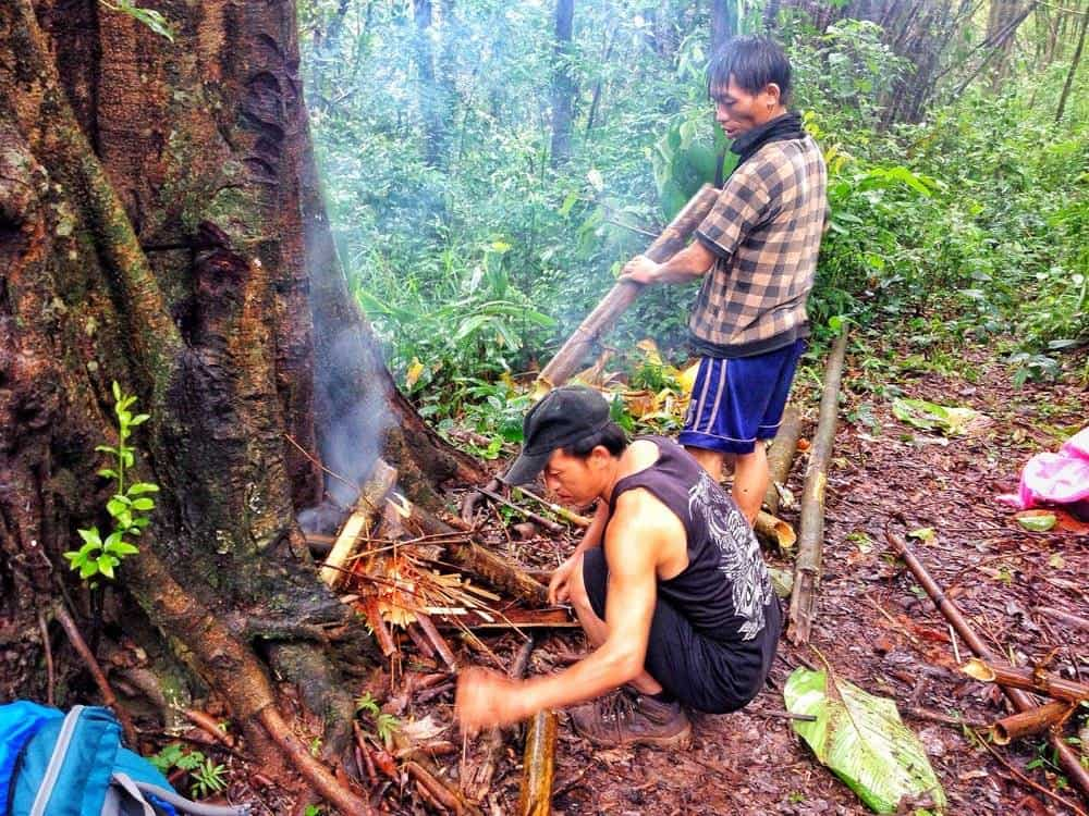 Building a fire in the Luang Namtha jungle
