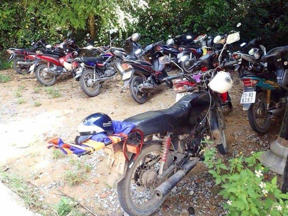 Motorbikes in Paradise Cave car park