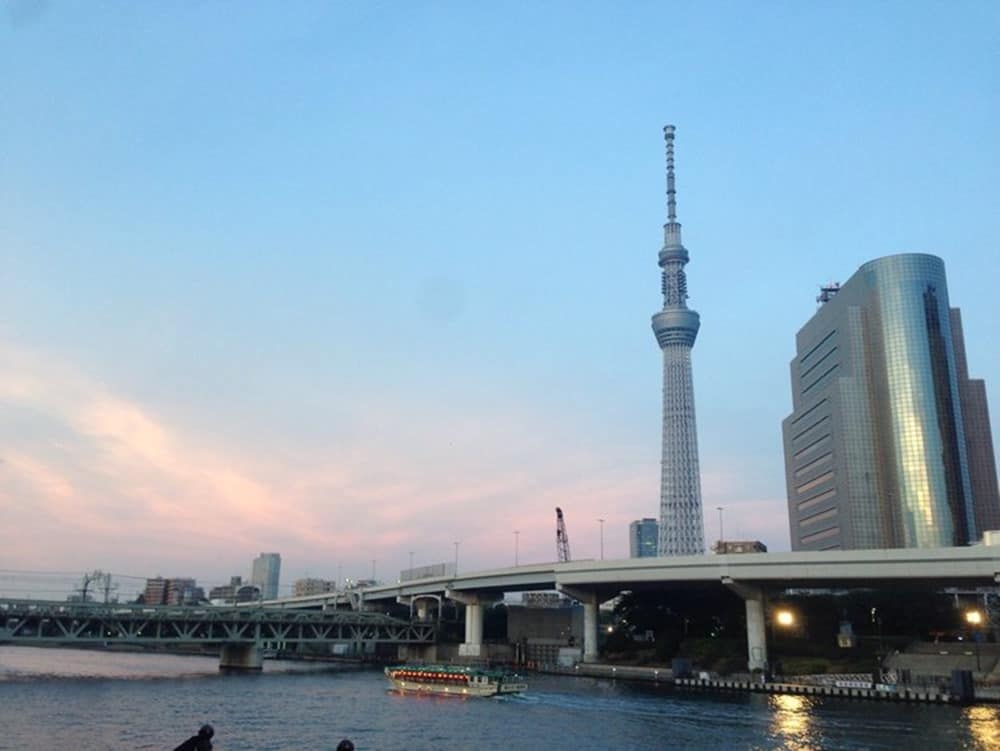 Their romantic evening spot by the river in Tokyo