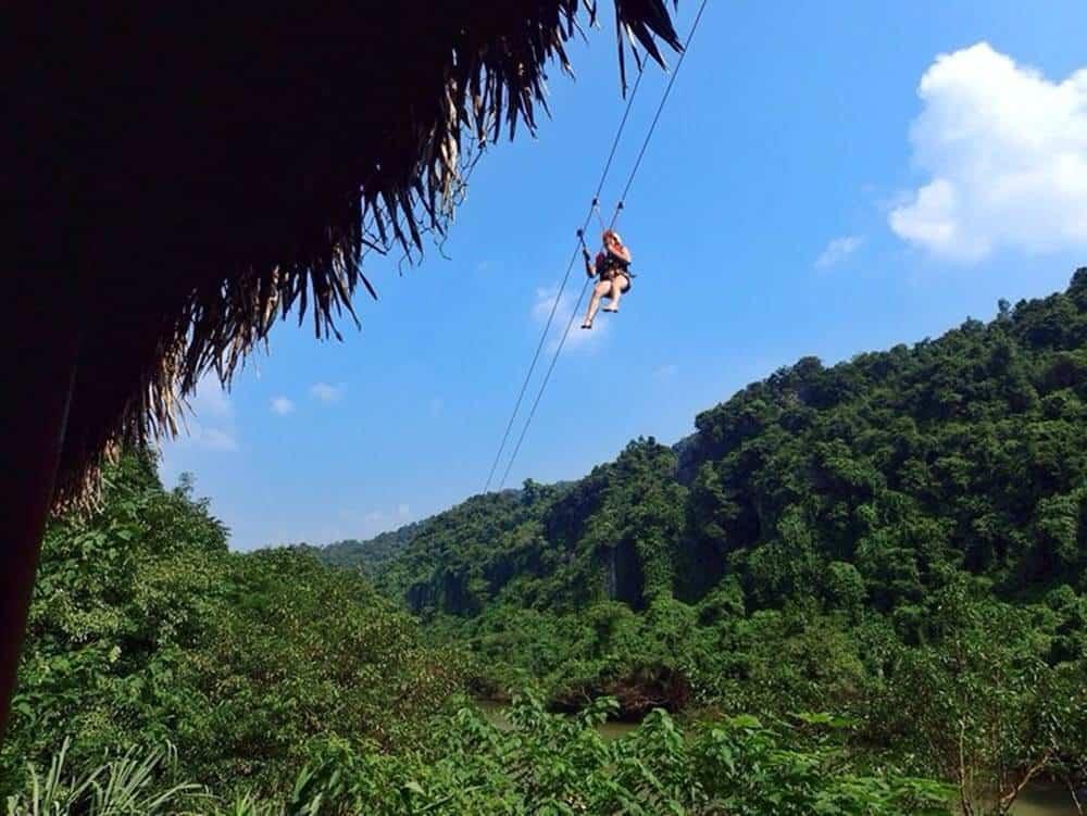 Ziplining through the jungle at Dark Cave