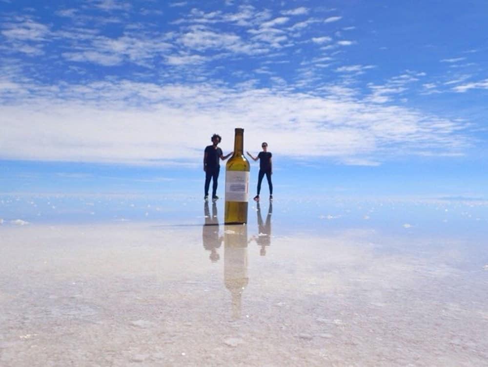 James and Sarah - wine bottle at Bolivian Salt Flats