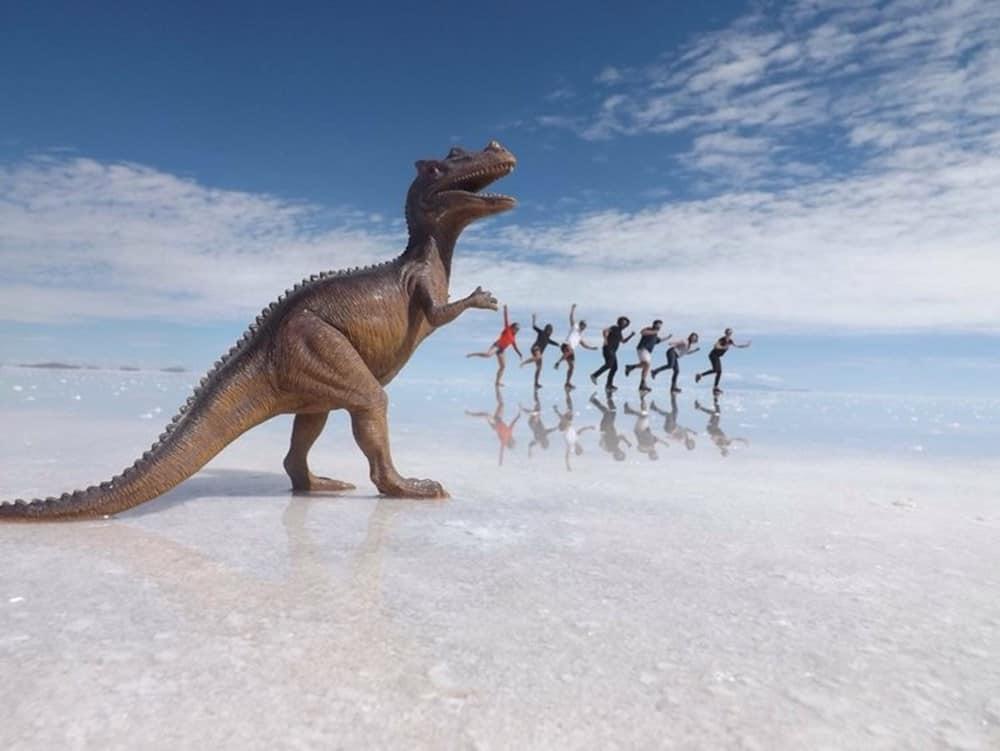 James and Sarah with friends and dinosaur at Bolivian Salt Flats