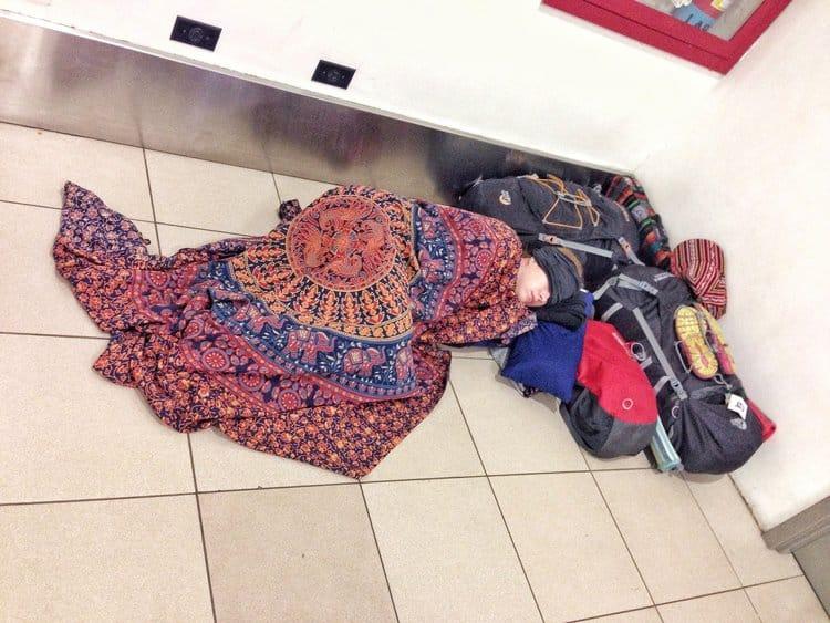 Sarah sleeping on airport
