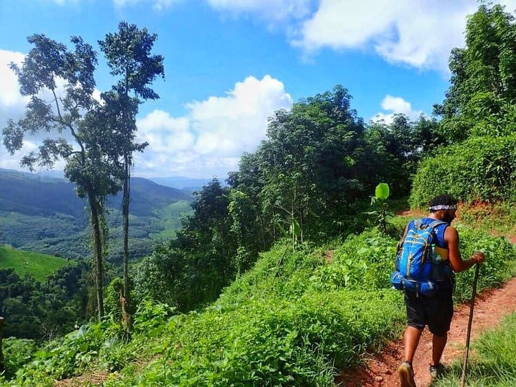 James trekking in rainy season in Laos