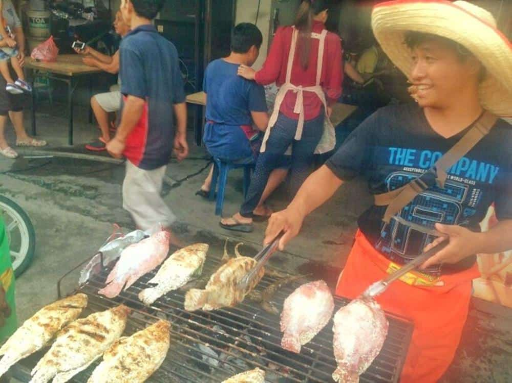 vendor grilling fish