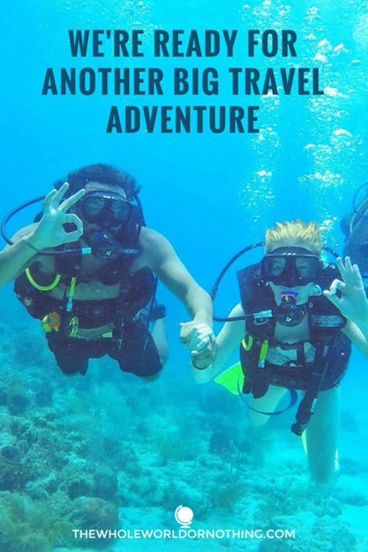 James and Sarah diving with text overlay WE'RE READY FOR ANOTHER BIG TRAVEL ADVENTURE