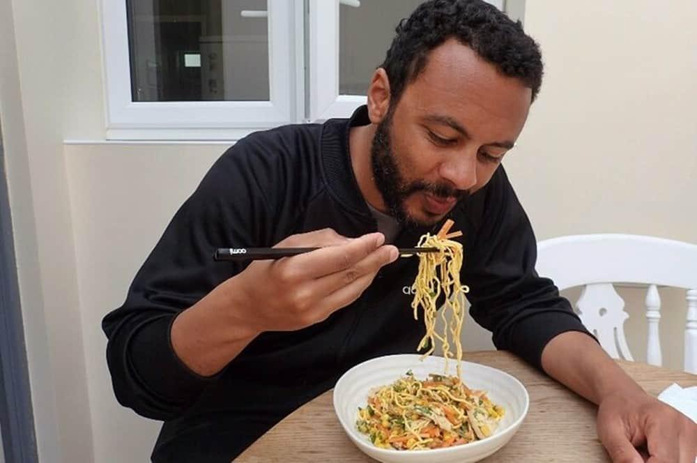 James eating noodles
