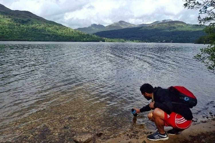 James filling his water bottle from Loch Lomond
