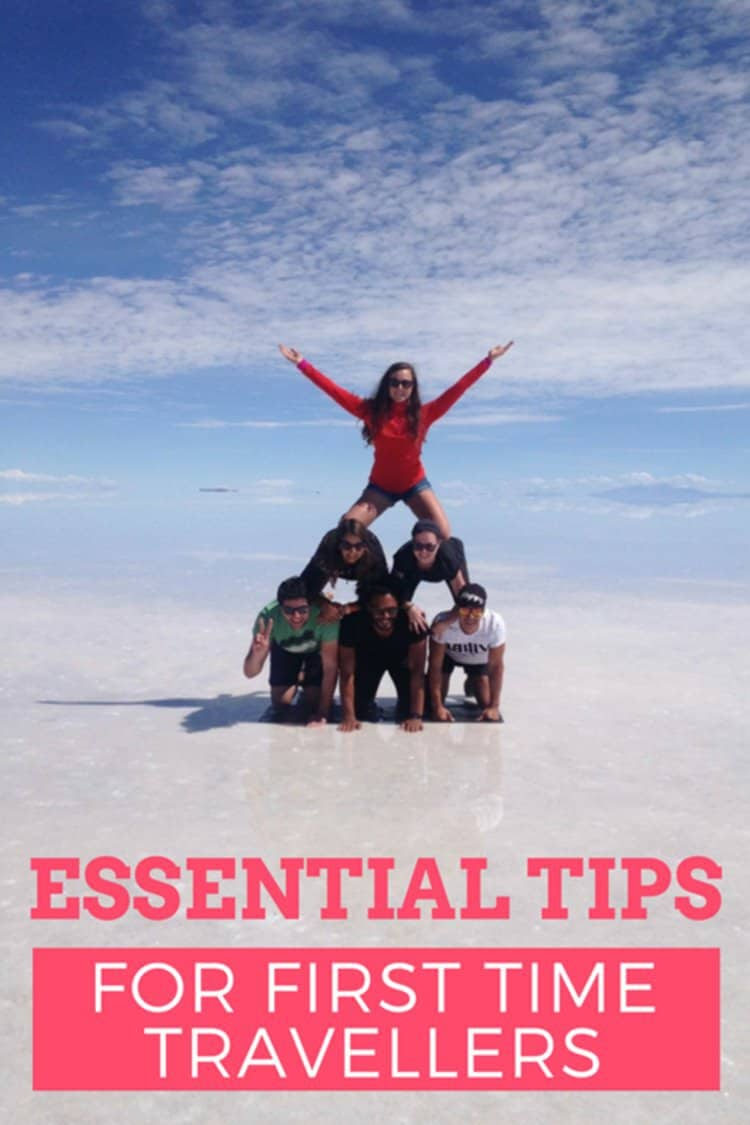 jJames and Sarah with friends at Bolivian salt flats with text overlay Essential tips for first time travellers