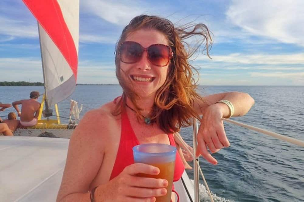 Sarah drinking juice on a boat