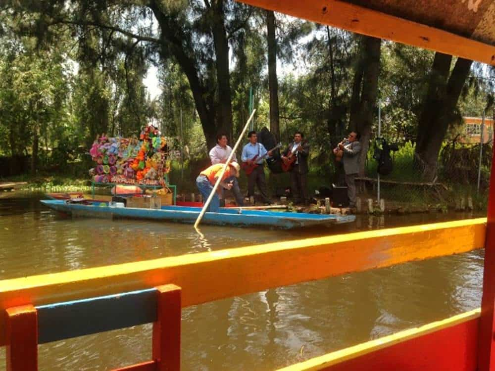 Xochimilco trajineras with mariachi bands