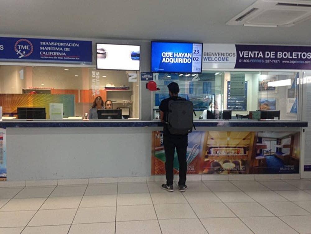 James buying ticket