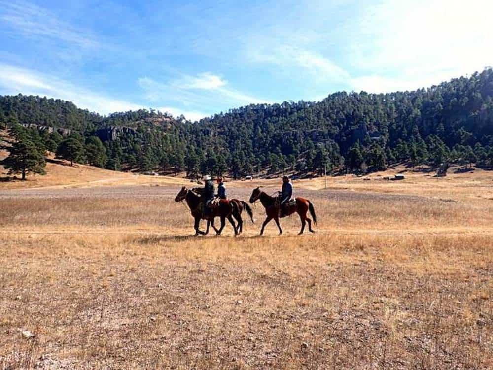 men-riding-horse