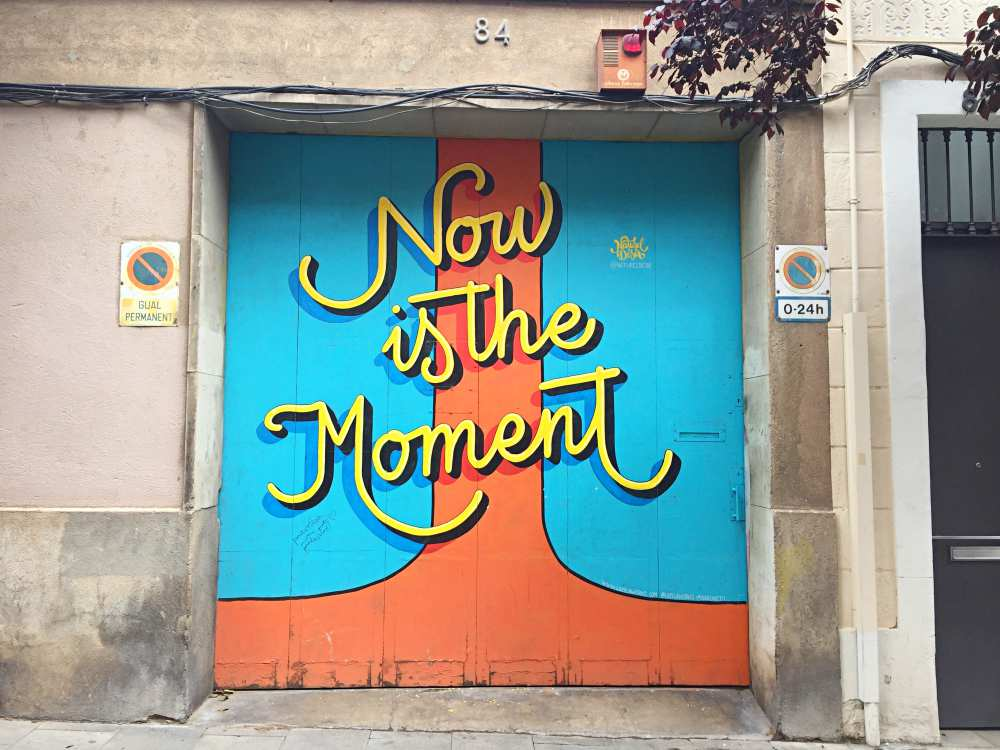 Graffiti saying Now Is The Moment