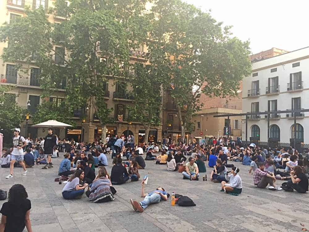People sat in Placa del Sol in Gracia Barcelona