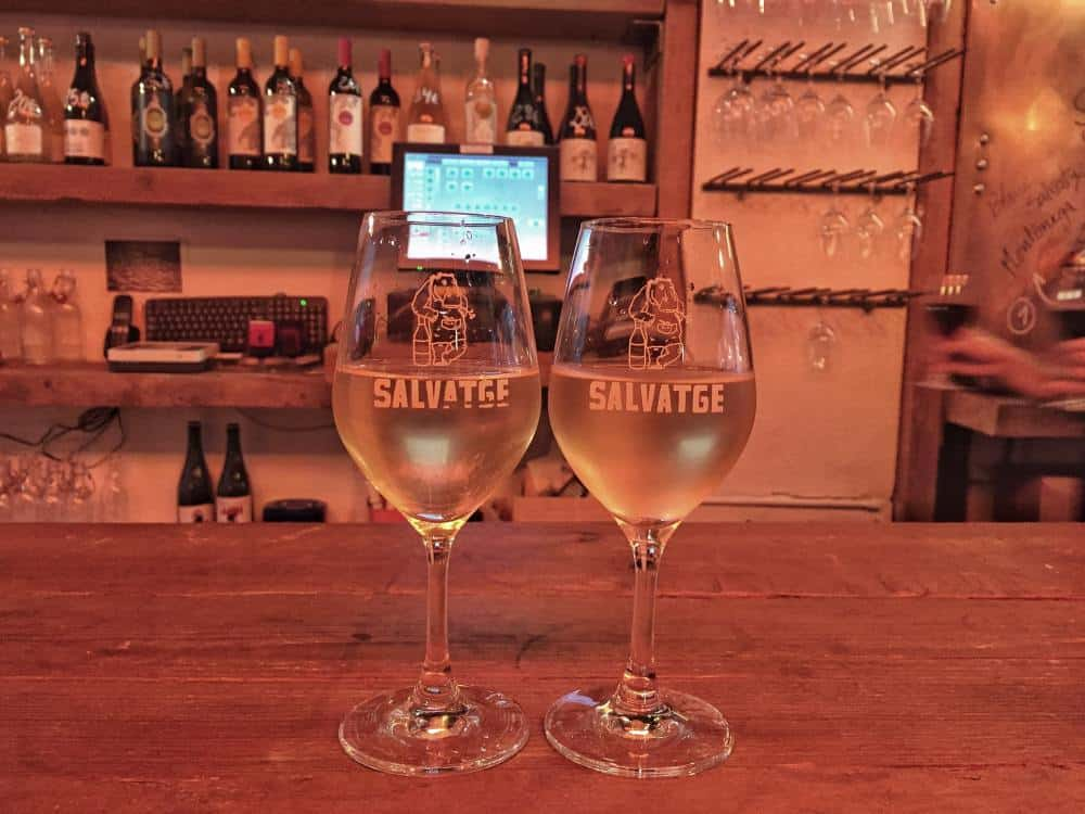 Two wine glasses filled with white wine