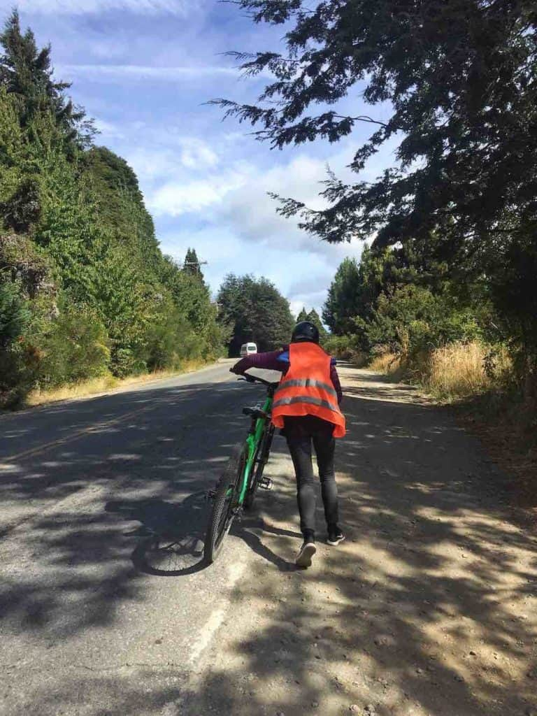 Sarah pushing bike on Circuito Chico Bariloche