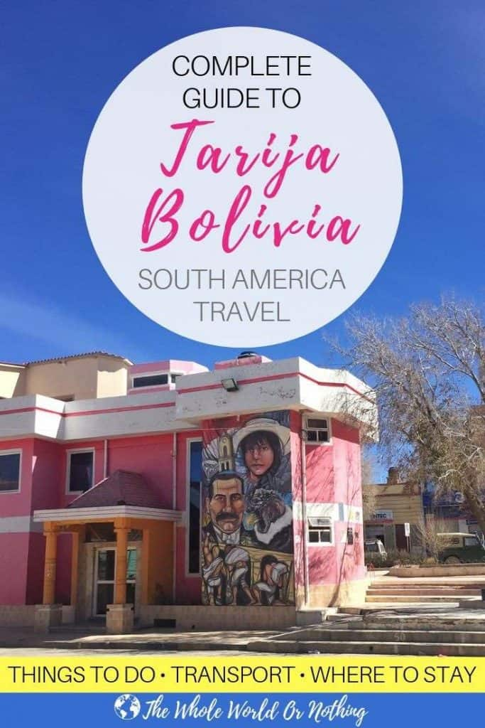 Street art on Bolivian building with text overlay Complete Guide To Tarija Bolivia