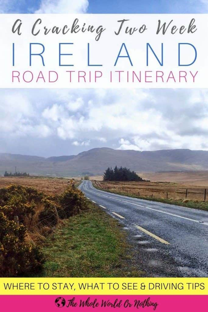 Road with mountains in background and text overlay Two Week Ireland Road Trip Itinerary